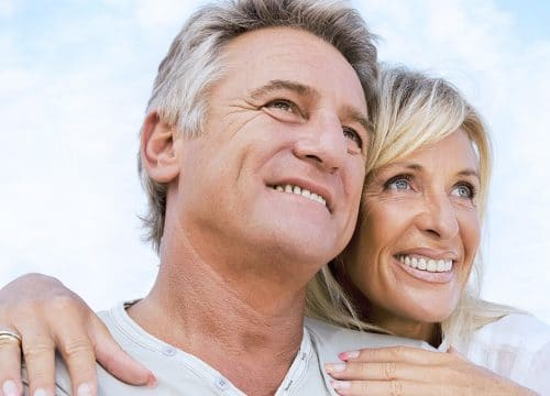 Smiling older couple after annual physicals
