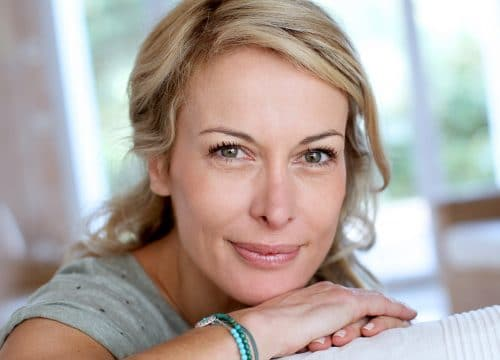 Middle-age woman with great skin after anti-aging treatments