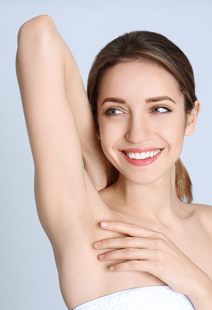 Woman showing off a hairless armpit