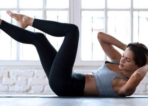Woman working out at home after TempSure® Firm treatments